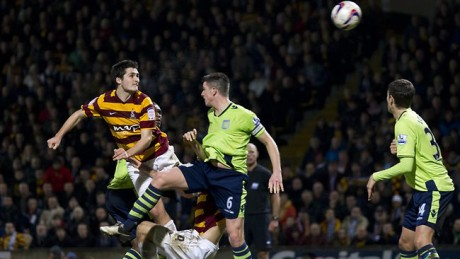 Carl McHugh scores Bradford's third goal on   against Aston Villa in the 2012/13 Carlin Cup semi-final