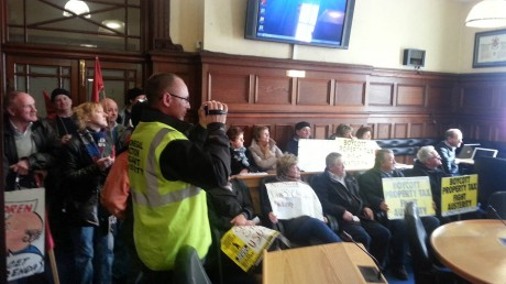 Protestors in the council chamber.
