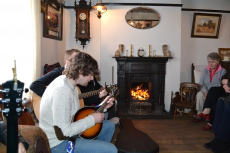 Declan McClafferty of In Their Thousands entertains by the fireside at Teach John Mickey Ban's in Carrigart.