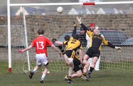 Andrew Kelly scoring St Michael's second goal as St Eunan's keeper JP Clarke is just out of reach. Photo: Donna McBride