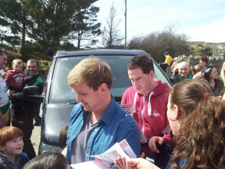 Shane and Kian signing autographs during a visit to Shane's home in Downings this week.