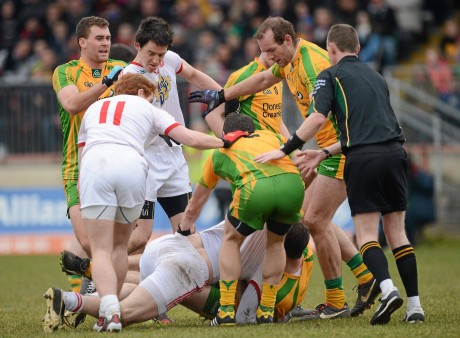 Stephen O'Neill, Tyrone, and Neil McGee, Donegal, during an altercation as players from both sides and the referee close in during the League meeting in March.