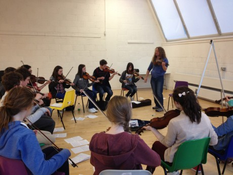 Ceol na Coille fiddle players rehearsing with Tola Cust ahead of this weekend's concert with Blazing Bows.