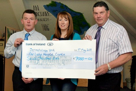 James Barrett and Davey McCarron presenting Angela Gallagher with a cheque for €7,000 for the dermatology unit at Our Ladys Childrens Hospital Crumlin. Angela is baby Lucy's aunt.