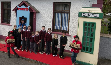Children from Scoil Treasa Naofa in Malin queuing for the a sneak preview of the phonebox cinema.