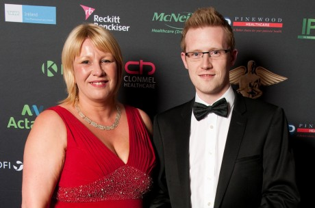 Pharmacist Jason Duffy, a Gaoth Dobhair native who works at Healthwise Sligo, receives his Manager Of The Year award.