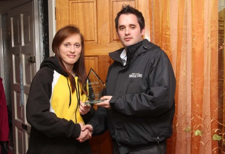 Donegal News Sports Writer Chris McNulty presents the April award to Austeja Auciute.