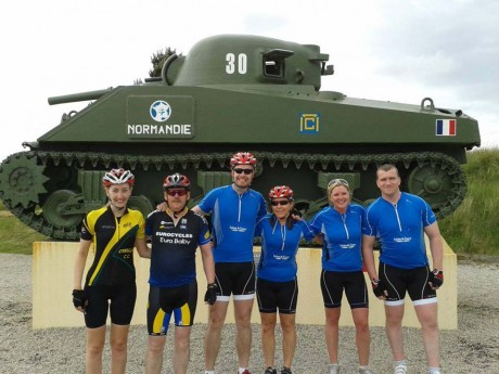 Jordanna (left) with a group of fellow cyclists at Utah beach.