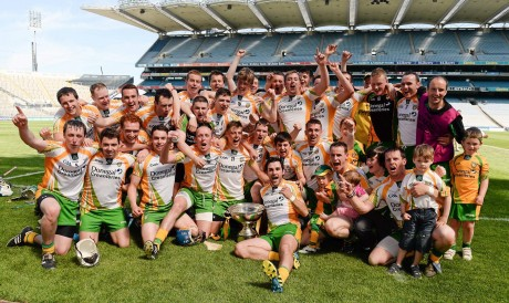 The Donegal team celebrate with the Nicky Rackard cup.