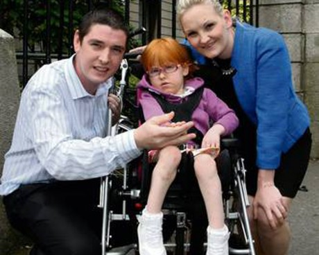 Sarah McFeely with her parents Ray and Bronagh at the High Court in Dublin. Photo: Courtpix