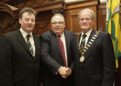 Frank McBrearty, outgoing mayor and Seamus Neely, county manager, congratulate the new county mayor Ian McGarvey at the agm on Monday.