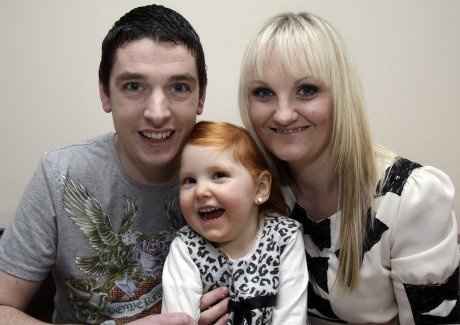 Ray McFeely and Bronagh Colhoun and their daughter Sarah (4).