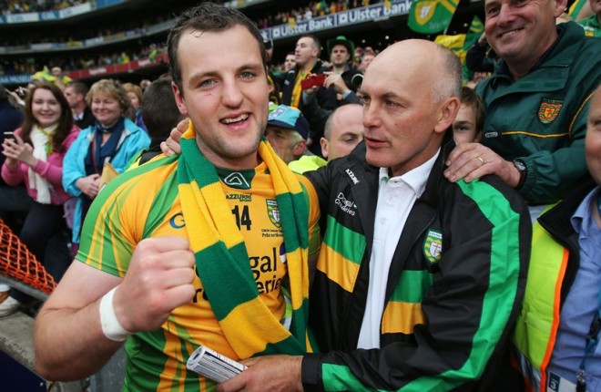 Michael Murphy is congratulated by Anthony Molloy after the All-Ireland final. They will be in opposition camps tomorrow.