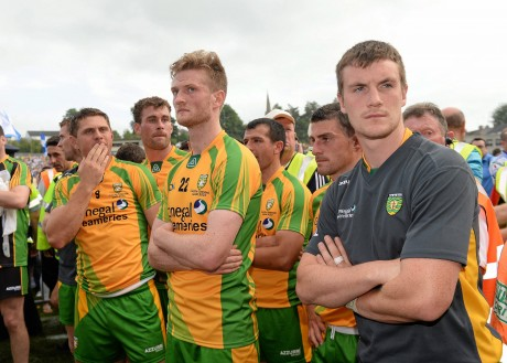 A dejected Ryan Bradley, Ross Wherity and Leo McLoone, Donegal, at the end of the game