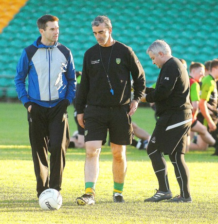 Rory Gallagher, Jim McGuinness and Pat Shovelin having a chat at training before the Ulster final.