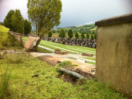 A wall collapsed at Conwal Cemetery, Letterkenny, following flash flooding in the area.