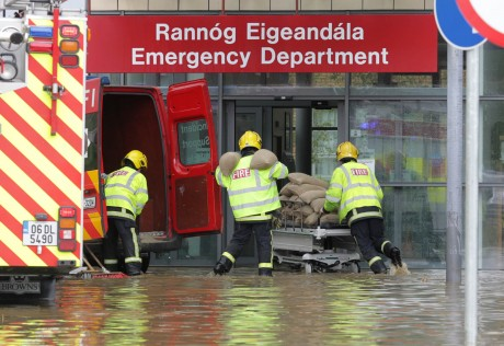 Fire officers bring sand bags into the new multi million euro Emergency Department after flash floods in Letterkenny. Photo: Donna McBride