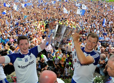 Owen Lennon, right, and Conor McManus lift the Anglo-Celt Cup.