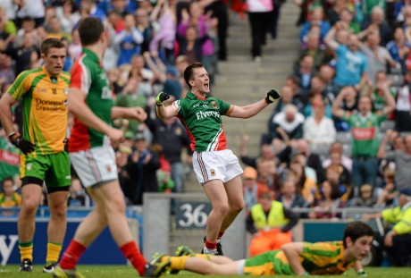 Donegal's Ryan McHugh lies on the ground as Cillian O'Connor celebrates after scoring his third and Mayo's fourth goal.