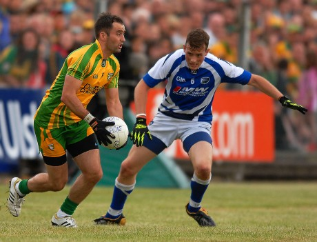 Karl Lacey looks up for a team mate to pass to, as Kieran Lillis keeps his eye on the ball, for Laois.