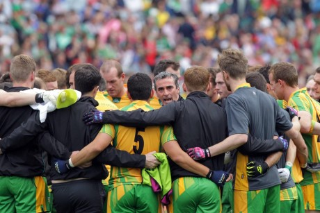 Donegal manager Jim McGuinness speaking to his squad before throw-in. Photo: Donna McBride
