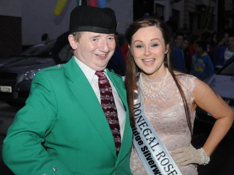 The Donegal Piper Christy Murray pictured with Donegal Rose Catherine McCarron at the homecoming in Raphoe on Friday night. Christy had led the parade as Catherine was brought through the town to St Eunan's Terrace.