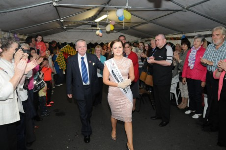 Huge applause as Donegal Rose Catherine McCarron is led into the marquee in St Eunan's Terrace by her father John on Friday night.