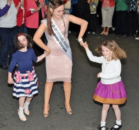 Donegal Rose Catherine McCarron dancing with her nieces Hannah and Ella at the special homecoming in her honour in Raphoe on Friday night.