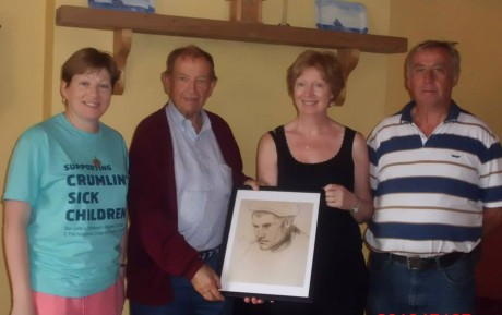 Valentine Lamb making a presentation to myself, Mairin Ui Fhearraigh of a painting by his father Henry lamb of a Gola Island Fisherman. Also pictured are Sile Ui Ghallchoir and Eamon Mac Aoidh. Photo: Michelle Nic Aoidh