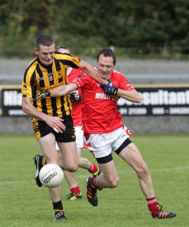St Eunan's Kevin Rafferty in action against Stephen Coyle of St Michaels. Photo: Donna McBride.