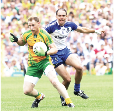 Anthony Thompson in possession against Paul Finlay of Monaghan during last weekend's Ulster final.