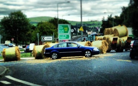 A hay load falls off a trailor at Lifford Roundabout.