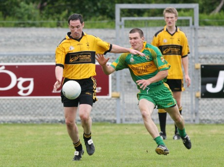 Declan Gallagher, during his full-back days, tackles Brendan Devenney