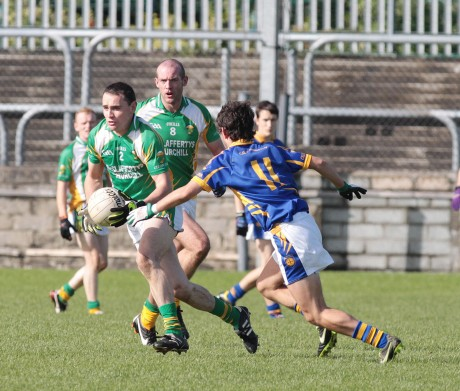 Aidan McDevitt, Glenswilly in possession against Ryan McHugh of Kilcar.