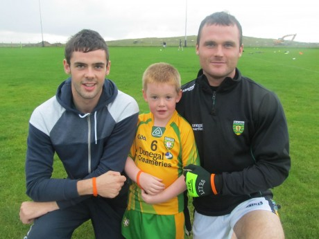 Odhran McNeilis and Neil McGee with Conor McEntee wearing the spina bifida wrist bands.