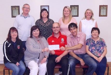Seamus Hamilton presenting a cheque to SVP members. Included are, Charlie Doherty, Cathy Kelly, Diane Gallagher, Lisa O'Brien. (Front Row) Marie McColgan, Anne Marie Kelly, Seamus Hamilton, Joe Carlin, Alice Doherty.