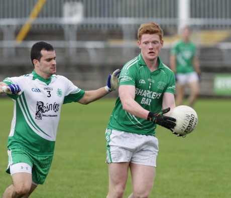 Paul 'Yank' Boyle in possession against Johnny Gallagher of Aodh Ruadh.