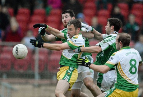 Eamon Ward and Neil Gallagher in action against Seamus Quigley and Kevin Cosgrove