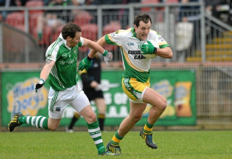 Michael Murphy powers past Niall Cassidy.