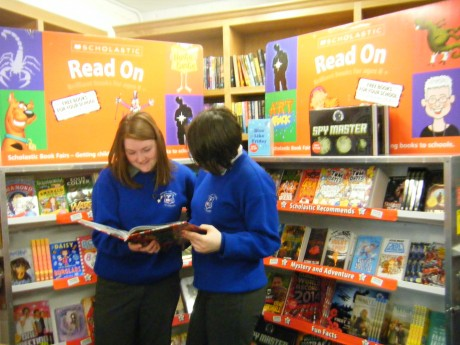 Caption: Kirsty McMenamin and Ciara Murray with their heads in a book!