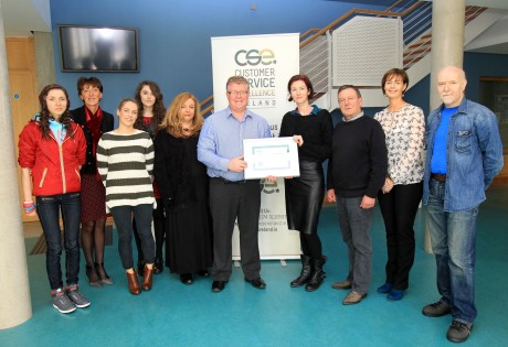 Charlie Boyle, Customer Service Excellence, Ireland making a presentation to Edel Corcoran, Earagail Arts Festival, also included are volunteers and EAF members Alison Graham, Patricia Graham, Aisling Viera, Kerry Graham, Caroline Jahn, Donegal Volunteer Centre, Gary Gomringer, Karen Murphy and Fintan Moloney.