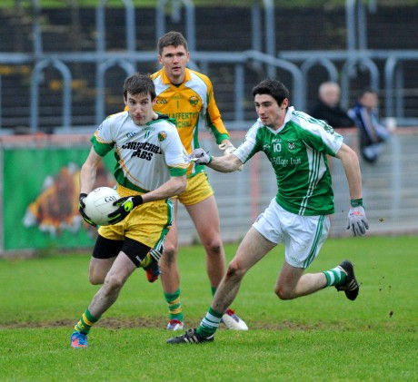 Glenswilly's Joe Gribbons is stretched by Roslea's Niall Cosgrove