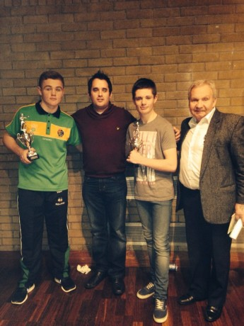 Donegal News Sports Writer Chris McNulty who presented some of the prizes at the tournament, with boxers Brett McGinty and Callum Toland. Also included is Donegal Boxing Board PRO Peter O'Donnell.