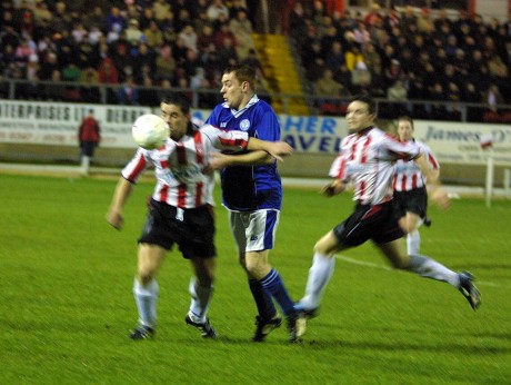 Niall Bonner in a tussle for possession at the Brandywell.
