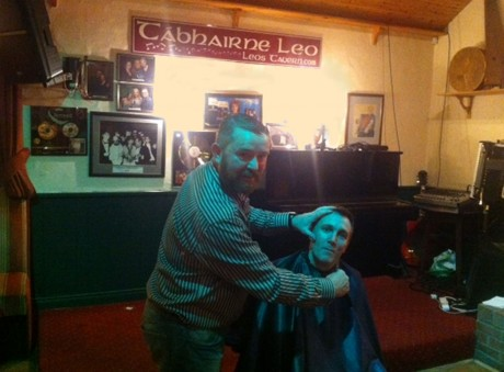 Cameron Campbell gets his 'Mo' shaved off by Dungloe barber Patrick Quinn.