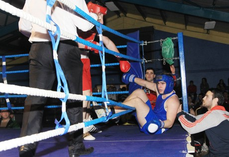 Tom McDonagh, Olympic BC gets beaten out of the ring by Michael Gallagher, Finn Valley Boxing Club. Photo: Donna McBride