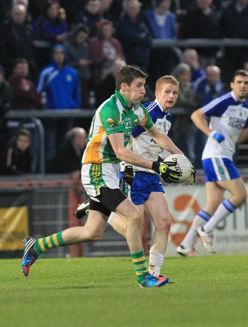 Joe Gibbons in action for Glenswilly against Coilin Devlin of Ballinderry.