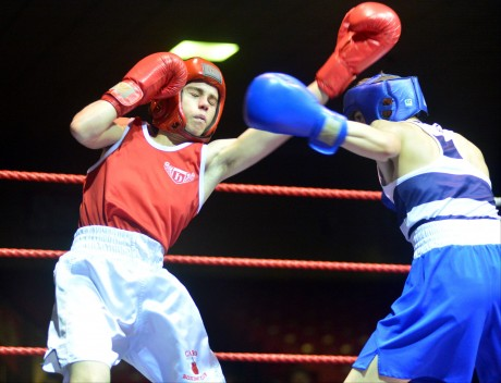 Liam Callaghan, Cardonagh (red) v Brendan Irvine, St Pauls (blue) winner,  in the 49kg at the National Open Youth Championships final at the National Stadium.