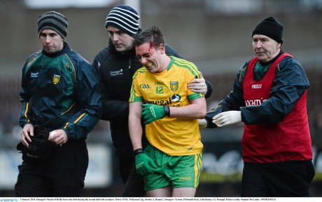 Martin O'Reilly leaves the field during the second half of Sunday's game against Tyrone with an injury.