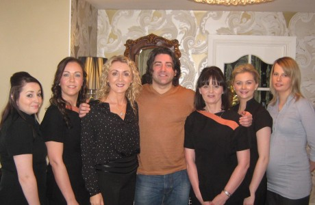 Brian Kennedy with Mary Ferry (third from left) and her team at the Genesis Skincare & Laser Clinic.